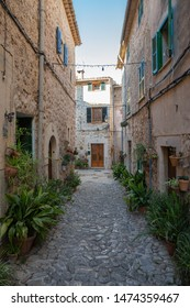 Valdemossa, Spain - 30.05.2019: A cozy street  with flowers in the old town of Valdemossa