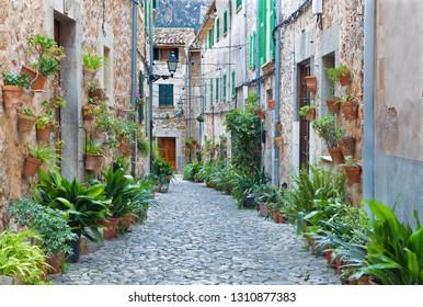VALDEMOSSA, SPAIN - JANUARY 28, 2019: The old aisles of Valldemossa village.