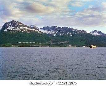 Valdez, Alaska - The southern terminal for the 1290 km long Trans-Alaska Pipeline is located here, in a natural fjord of Prince William Sound. Valdez Arm was first explored by the Spanish in 1790.