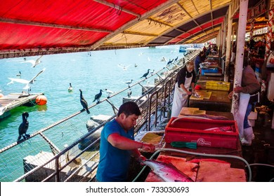 VALDIVIA, CHILE - OCTOBER 30, 2016: Famous fish market in Valdivia. There are a lot of sea lions and birds around which attract tourists even more.