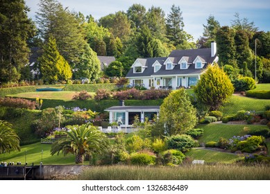 Valdivia, Region de los Rios / Chile - February 07 2019: Luxury houses at the border of Valdivia river in Chile