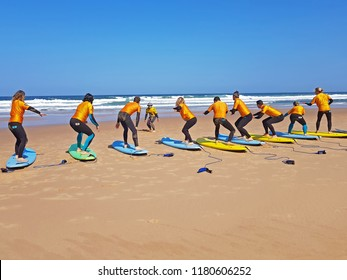 VALE FIGUEIRAS, PORTUGAL - AUGUST 25, 2018: Surfers getting surfers lessons at Praia Vale Figueieras in Portugal