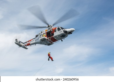 VALENCIA COAST, SPAIN - DECEMBER 25: The helicopter of the Spanish Maritime Rescue Team and his rescuers during rescue exercises, on December 25, 2014 in Valencia coast.