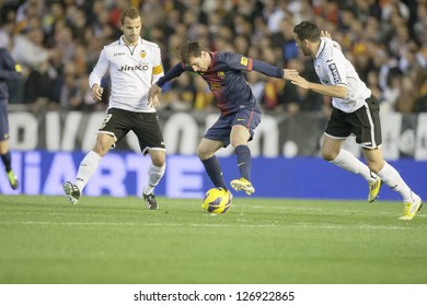 VALENCIA - FEBRUARY 3: Leo Messi with ball during Spanish League match between Valencia CF and FC Barcelona, on February 3, 2013, in Mestalla Stadium, Valencia, Spain