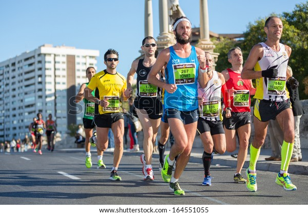 VALENCIA - NOVEMBER 17: Antoni Oliver Rubio (number 267) leads his group during his participation in Valencias marathon on November 17, 2013 in Valencia, Spain