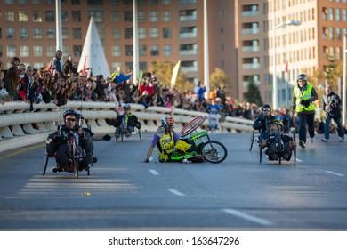 VALENCIA - NOVEMBER 17: Paco Valen (number 98) hand-biker starts marathon with an accident over his handicapped wheel chair in Valencias Marathon on November 17, 2013 in Valencia, Spain