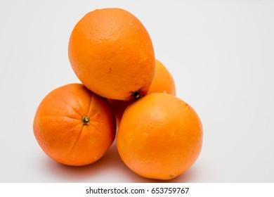 Valencia oranges on white background