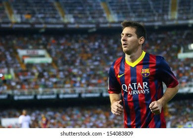 VALENCIA - SEP, 01: Leo Messi of FC Barcelona in action during a Spanish League match between Valencia CF and FC Barcelona at the Mestalla Stadium on September 01, 2013 in Valencia, Spain