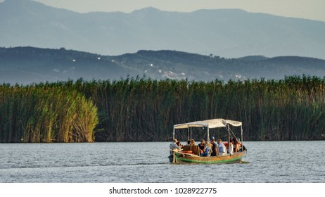 VALENCIA - SEPTEMBER 12: Unidentified group of tourists enjoy a tour around albufera lake over boat in Valencia on September 12, 2017