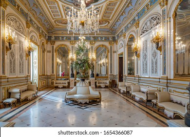 Valencia / Spain - 11-07-2019: The impressive ballroom of the Museo Nacional de Ceramica in Valencia, with beautifully decorated sofas and crystal chandeliers, Spain