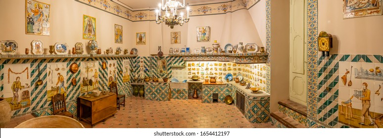 Valencia / Spain - 11-07-2019: A panorama photo of the kitchen in the Museo Nacional de Ceramica in Valencia, totally full of ceramic utensils and images, Spain