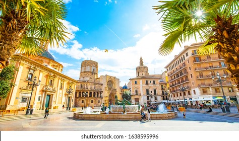 VALENCIA, SPAIN – 14 March 2019: Panoramic view of Plaza de la Virgen (Square of Virgin Saint Mary) and old town in Valencia. Colorful sunny landscape view of center city.