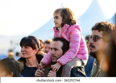 VALENCIA, SPAIN - APR 5:  A kid sitting on the shoulders of his father at MBC Fest on April 5, 2015 in Valencia, Spain.