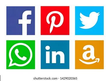 Valencia, Spain - April 12, 2017: Collection of popular social media logos printed on paper: Facebook, Twitter, LinkedIn, Pinterest, WhatsApp,Amazon.