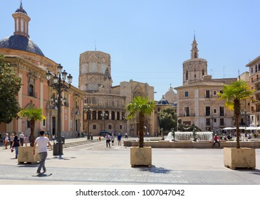 VALENCIA, Spain - April 23, 2014: Plaza de la Virgen at midday, with tourists walking by and the cathedral in the background