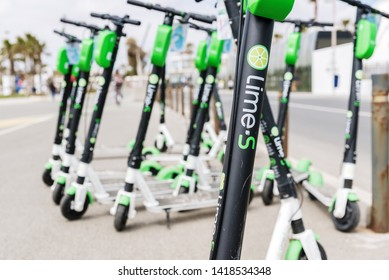 Valencia, Spain - April 29, 2019: Group of electric scooters for rent from the company Lime, arranged in the most tourist streets of the city.