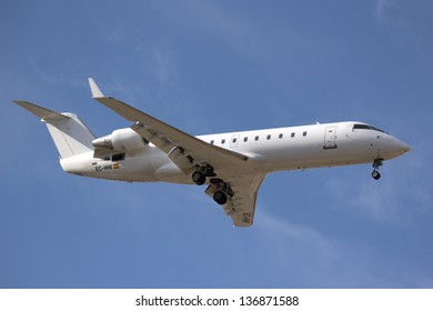 VALENCIA, SPAIN - APRIL 30: An Air Nostrum regional jet aircraft landing at the Valencia airport on April 30, 2013 in Valencia, Spain. Air Nostrum has 91 domestic and 51 international routes.