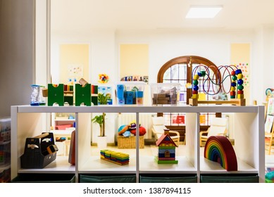 Valencia, Spain - April 4, 2019: Shelf with materials and games in a children's classroom.