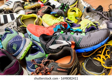 Valencia, Spain - April 7, 2020: Pile of used running sports shoes from various brands.