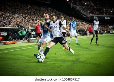 VALENCIA, SPAIN - APRIL 8: (L) Darder, Gaya during Spanish La Liga match between Valencia CF and RCD Espanyol at Mestalla Stadium on April 8, 2018 in Valencia, Spain