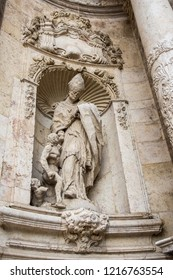 Valencia, Spain. Architecture detail of famous Cathedral statue