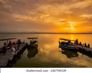 Valencia, Spain, August 15, 2017. pier of the Albufera during sunset. Several boats make excursions to tourists throughout the day.