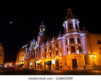 VALENCIA, SPAIN - AUGUST 21, 2018. Town Hall building on Plaza del Ayuntamiento in Valencia at night, Spain.