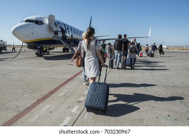 Valencia, Spain - August 22, 2017. Passengers get on board a Ryanair Boeing 737-800 (EI-DWV), as it gets ready for departure at the apron of Valencia Airport.