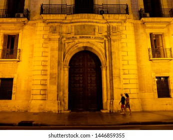 VALENCIA, SPAIN - AUGUST 27, 2018. Facade of the Superior Court of Justice of the Valencian Community (Tribunal Superior de Justicia), also known by its abbreviations TSJCV at night.