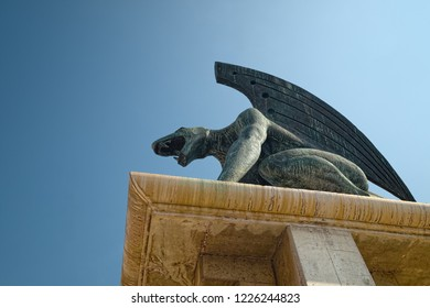 """VALENCIA, SPAIN - AUGUST 30, 2018: Demonic figure, one of four bronze sculptures of """"The Guardians of the Bridge"""", made by sculptor Joan Marti in 1999 for Pont del Regne bridge (Bridge of the Kingdom)"""