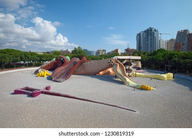 VALENCIA, SPAIN - AUGUST 30, 2018: Free public park with giant stylized Gulliver sculpture 70 meters in length, built for kids and adults to climb over and slide down, opened in 1990.