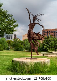 VALENCIA, SPAIN - AUGUST 30, 2018: Iron sculpture of a dancing girl in public park Jardines del Turia (Gardens of Turia) of Valencia city.