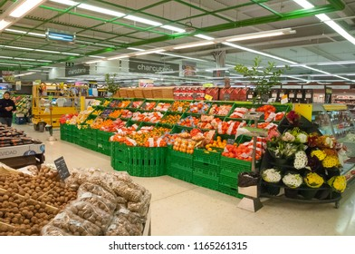 Valencia, Spain - december 04, 2010: Hallways full of displays with fruits and vegetables inside a large shopping center on the outskirts of the city