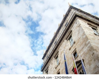 Valencia, Spain - December 10, 2016: A landscape of the historical Valencin Community Palace (Palau de la Generalitat)  with European, Spanish and Valencian flags, in Valencia, Spain