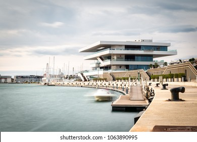 VALENCIA, SPAIN - DECEMBER 10, 2017: The Americas Cup Pavilion in the Marina of Valencia, Spain, also known as Veles e Vents, on a cloudy Winter morning. Long exposure.
