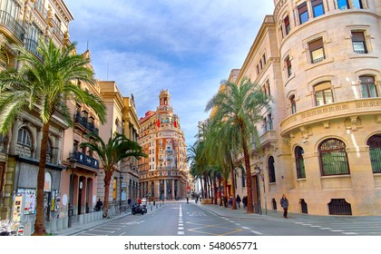 Valencia, Spain - December 25, 2016: Street in Valencia Spain. Palm Trees in Spanish City of Valencia