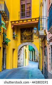 VALENCIA, SPAIN, DECEMBER 30, 2015: view of a narrow street situated in the historical centre of spanish city Valencia