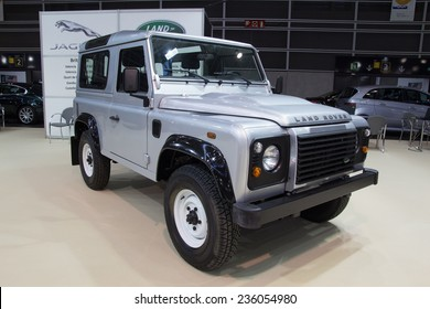 VALENCIA, SPAIN - DECEMBER 4, 2014: A silver 2013 Land Rover Defender at the Valencia Automovil 2014 Car Show. Production of the Defender model began in 1983.