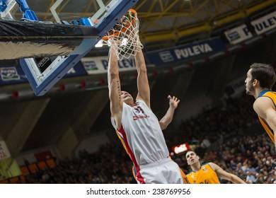 VALENCIA, SPAIN - DECEMBER 5: Zirbes with ball during Euroleague match between Valencia Basket Club and Crvena Zvezda Telekom Belgrade at Fonteta Stadium on Dicember 5, 2014 in Valencia, Spain