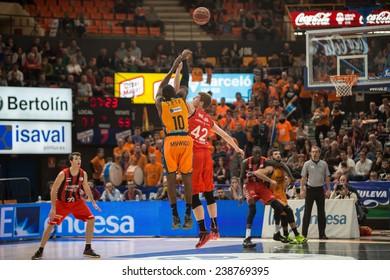 VALENCIA, SPAIN - DECEMBER 7:  10 Sato during Endesa Spanish League game between Valencia Basket Club and Laboral Kutxa Baskonia at Fonteta Stadium on December 7, 2014 in Valencia, Spain