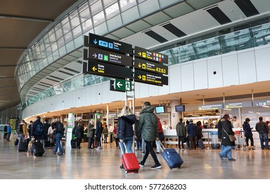 VALENCIA, SPAIN - FEBRUARY 12, 2017: Airline passengers inside the Valencia Airport. About 4.59 million passengers passed through the airport in 2016.