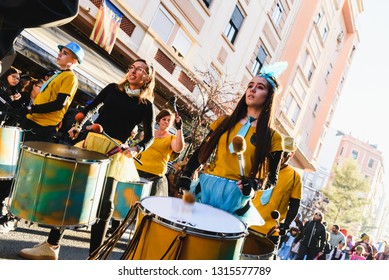 Valencia, Spain - February 16, 2019: Group of drummers of a Spanish batukada making their drums boom through the streets of the Ruzafa district during their carnival.