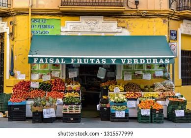 Valencia, Spain - February 16, 2019: Fruit and vegetable shop in a tourist street in Ruzafa neighborhood.