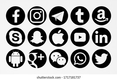 Valencia, Spain - February 16, 2020: Collection of popular social media logos printed on paper: Facebook, Instagram, Telegram, Tumblr, Skype, Snapchat, Apple, Google Plus, Android, WeChat,WhatsApp.