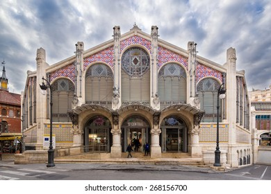 VALENCIA, SPAIN - FEBRUARY 17: People shopping entering the main entrance of the old central market, one of the most attractive and visited buildings, on February 17, 2015 in Valencia, Spain.
