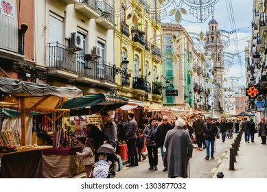 Valencia, Spain - February 2, 2019: People walking and shopping at a street market in the streets of the Ruzafa neighborhood.
