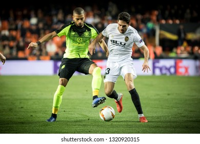 VALENCIA, SPAIN - FEBRUARY 21: (L) Toljan (R) Sobrino during UEFA Europa League match between Valencia CF and Celtic FC at Mestalla Stadium on February 21, 2019 in Valencia, Spain