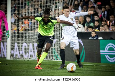 VALENCIA, SPAIN - FEBRUARY 21: (L) Boyata, (R) Gameiro during UEFA Europa League match between Valencia CF and Celtic FC at Mestalla Stadium on February 21, 2019 in Valencia, Spain