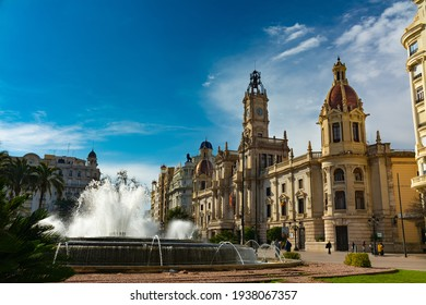 Valencia, Spain. February, 24, 2021 - City hall building in the town hall square, with the large fountain in the foreground