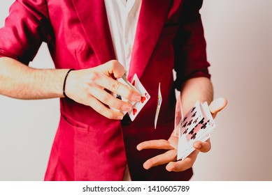 Valencia, Spain - February 4, 2019: Hands of magician doing tricks with a deck of cards.